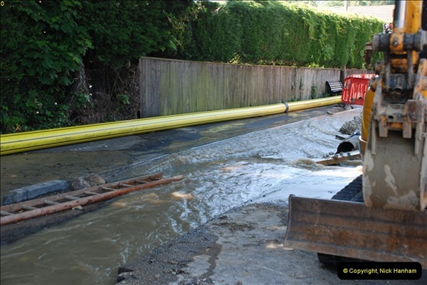 2012-06-18 Water Main cut by Gas people.  (18)086