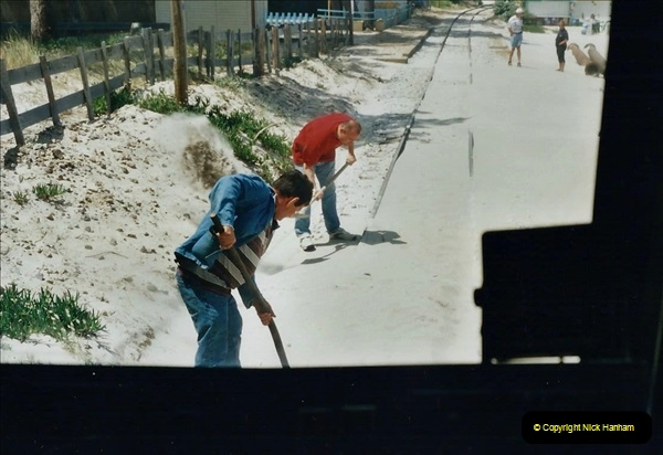 May 2001 France & Corsica. (130) Bastia to Calvi Corsica. Sand blown onto the track being cleared.129