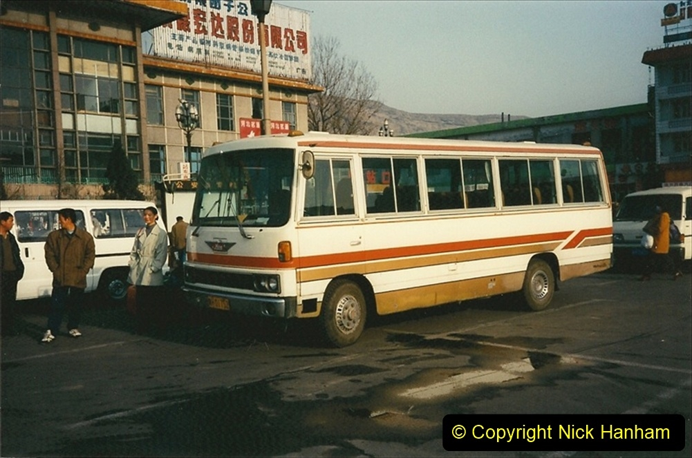 China 1997 November Number 2. (239) Leaving our Chengde Hotel for the station. 239