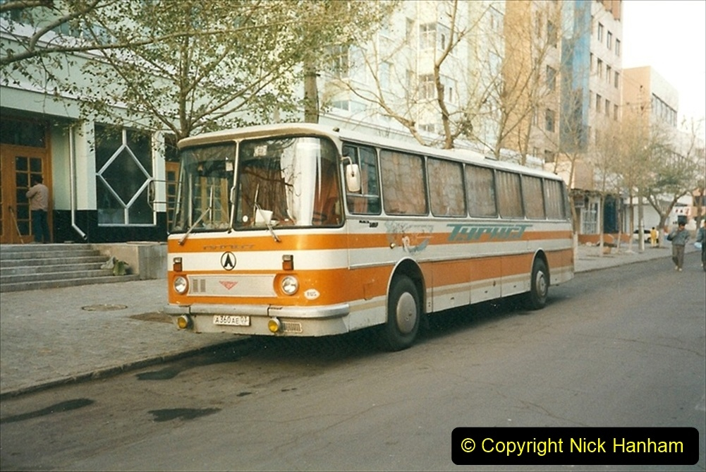 China 1999 October Number 1. (280) Only a mile from the Russian boarder we see two Russian coaches.