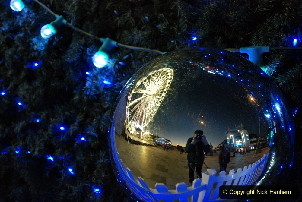 2019-12-09 Bournemouth Christmas Lights. (111) Your Host & Wife on reflection. 111