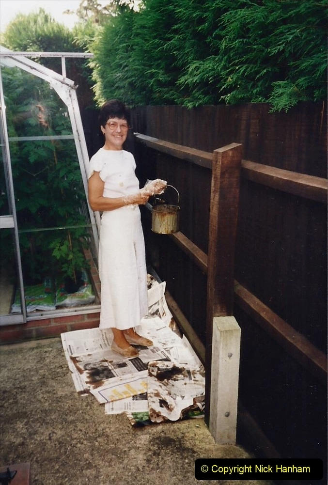 1995 Miscellaneous. (59) Your Host's Wife painting the house fences. 0558