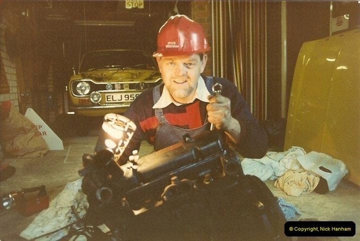 1982-03. Your Host working on his Mother's car engine. Poole, Dorset.277