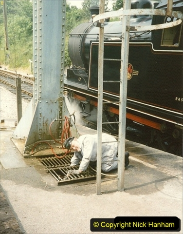 1990-06-14 Your Host driving 69621. Checking the tower for water level. (3) 118