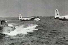 UNITED KINGDOM - FEBRUARY 10:  Two British Overseas Airways Corporation (BOAC), 1946. Two British Overseas Airways Corporation (BOAC). Short Sunderland flying boats at their moorings after returning from Calcutta to Poole Harbour on 4 February 1946. The passenger tender in the foreground.  (Photo by Science & Society Picture Library/SSPL/Getty Images)