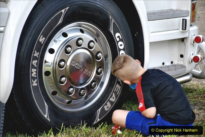 2020-09-05 Truckfest South West 2020 at Shepton Mallet. (306) This young lad was painting Good Year in white on the tyres. 306