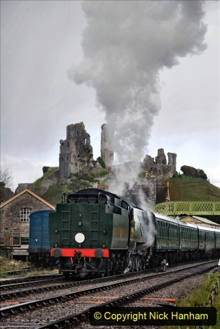2021-04-12 SR First public train of 2021. (104) First down train return working at Corfe Castle. 104