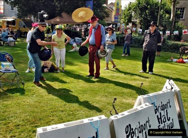 2021-09-04 Bridport Hat Festival. (117) On the Green. 111 Hat Hurling.