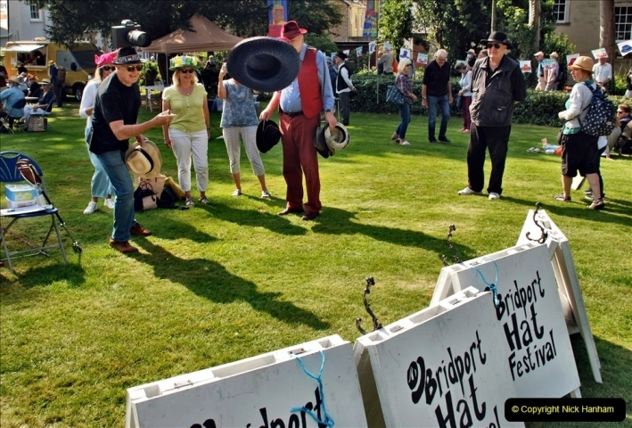 2021-09-04 Bridport Hat Festival. (118) On the Green. 111 Hat Hurling.