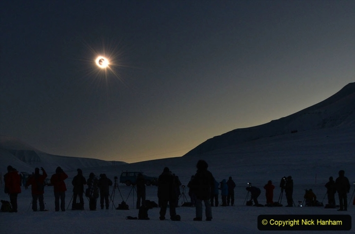 """People see the """"third contact"""" as the sun begins to appear from behind the moon during a total solar eclipse as viewed from Longyearbyen, Svalbard, an archipeligo administered by Norway March 20, 2015. Thousands gathering here as the only land the total eclipse will be seen from is on Svalbard and the Faoroe Islands off Iceland. AFP PHOTO/STAN HONDA"""