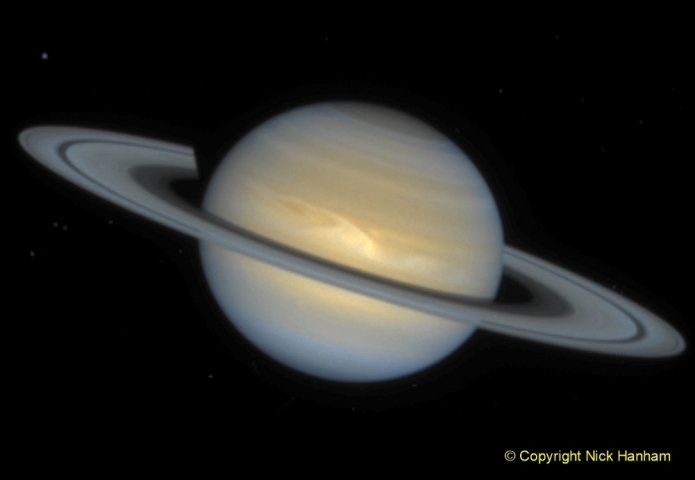This Hubble Space Telescope image of the ringed planet Saturn shows a rare storm that appears as a white arrowhead-shaped feature near the planet's equator. The storm is generated by an upwelling of warmer air, similar to a terrestrial thunderhead. The east-west extent of this storm is equal to the diameter of the Earth (about 12700 kilometres). Hubble provides new details about the effects of Saturn's prevailing winds on the storm. The new image shows that the storm's motion and size have changed little since its discovery in September, 1994.