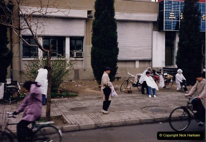 China 1993 April. (119) Beijing. On street barber.119