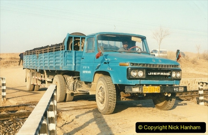 China 1997 November Number 1. (194) In 1997 nearly all trucks were painted in a standard blue. 194