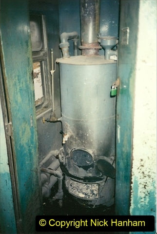 China 1997 November Number 2. (243) Train back to Beijing. Note the carriage boiler for hot water. 243