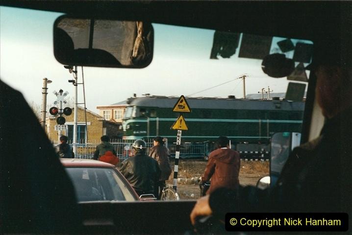 China 1999 October Number 1. (343) Jalinur Loco Works. Road transfer from Jalainur to Hailaer.