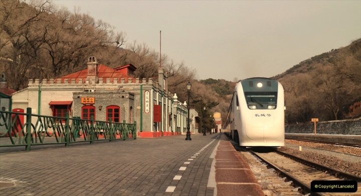 China & UK. (1) DEMU waiting at sidings of Qinglongquio Station, Nankow Pass near The Great Wall. 001