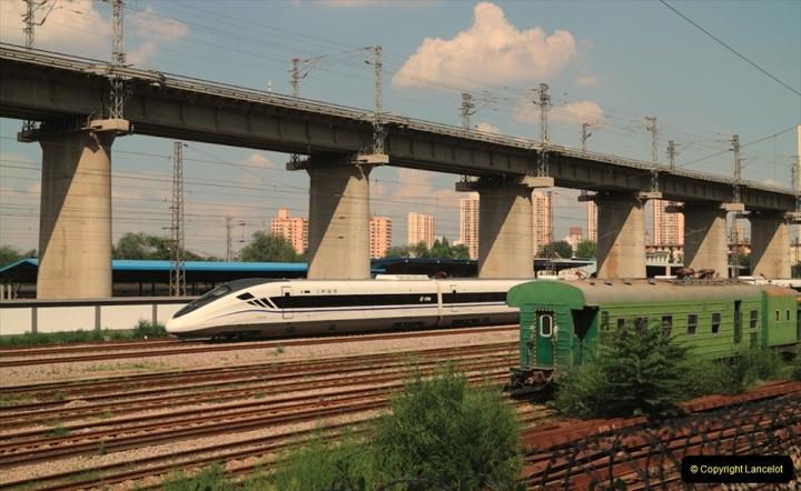 China & UK. (11) High speed EMU at Lanzhou -Xinjian railway. Track engineers coaches at right. 011