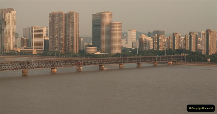 China & UK. (15) Passenger train passing over Qiantang railroad bridge in Hangzhou. 014