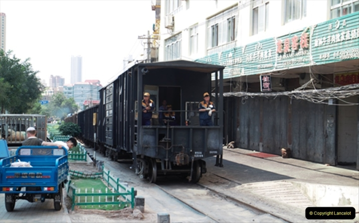 China & UK. (21)The Lanzhou branch in city limits with rare brake van. 021