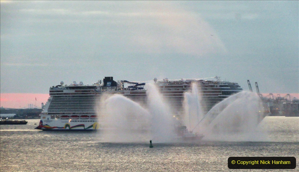 2019-11-10 New York. (380) Norwegin Encore & Norwegin Escape pass in NY Harbour with a tug boat water display escort. 380