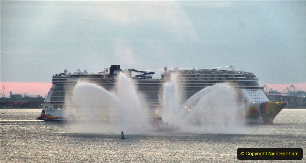 2019-11-10 New York. (381) Norwegin Encore & Norwegin Escape pass in NY Harbour with a tug boat water display escort. 381