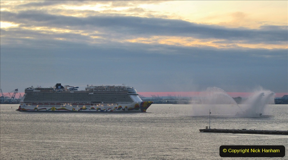 2019-11-10 New York. (383) Norwegin Encore & Norwegin Escape pass in NY Harbour with a tug boat water display escort. 383