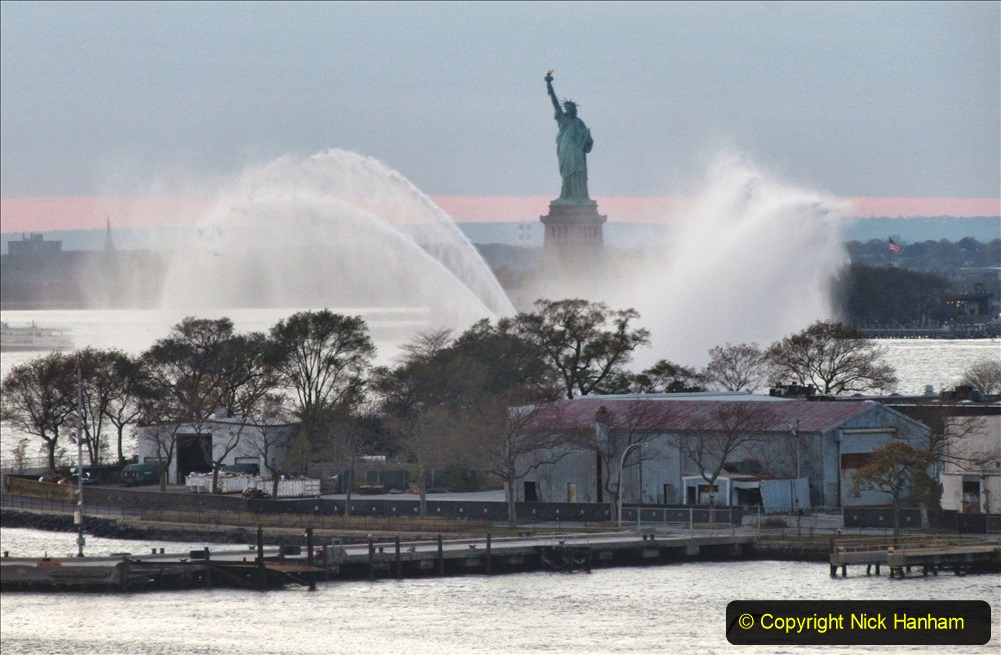 2019-11-10 New York. (384) Norwegin Encore & Norwegin Escape pass in NY Harbour with a tug boat water display escort. 384