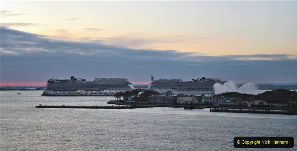 2019-11-10 New York. (390) Norwegin Encore & Norwegin Escape pass in NY Harbour with a tug boat water display escort. 390