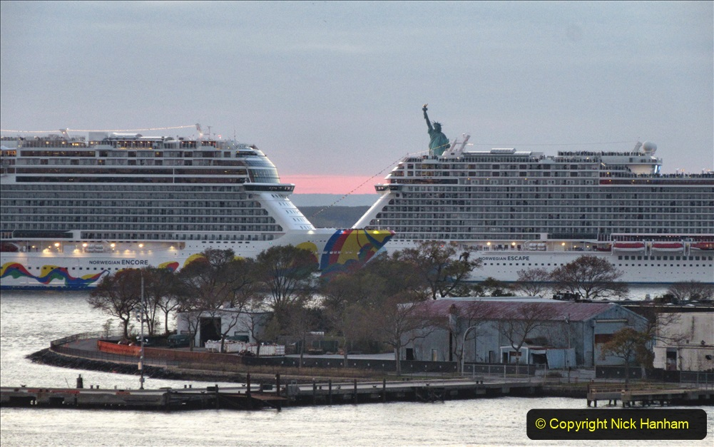 2019-11-10 New York. (391) Norwegin Encore & Norwegin Escape pass in NY Harbour with a tug boat water display escort. 391