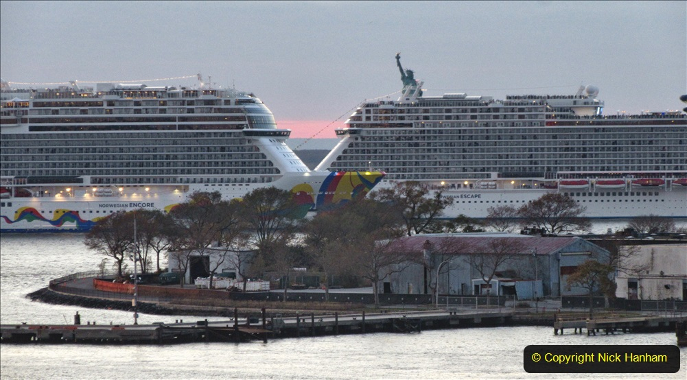 2019-11-10 New York. (392) Norwegin Encore & Norwegin Escape pass in NY Harbour with a tug boat water display escort. 392