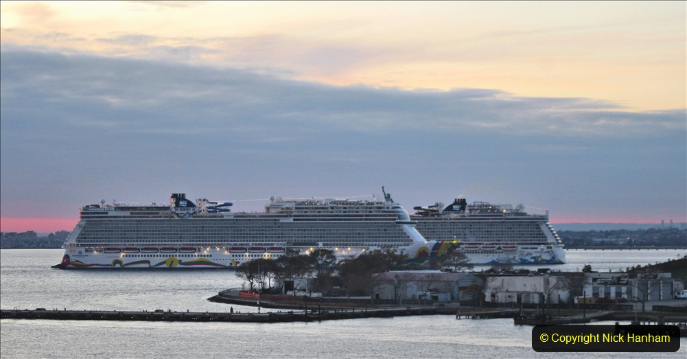 2019-11-10 New York. (395) Norwegin Encore & Norwegin Escape pass in NY Harbour with a tug boat water display escort. 395