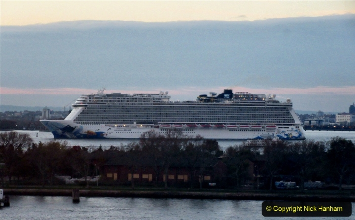 2019-11-10 New York. (382) Norwegin Encore & Norwegin Escape pass in NY Harbour with a tug boat water display escort. 382