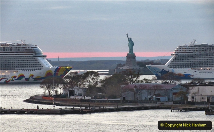 2019-11-10 New York. (387) Norwegin Encore & Norwegin Escape pass in NY Harbour with a tug boat water display escort. 387