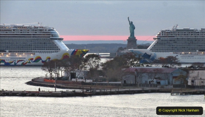 2019-11-10 New York. (388) Norwegin Encore & Norwegin Escape pass in NY Harbour with a tug boat water display escort. 388