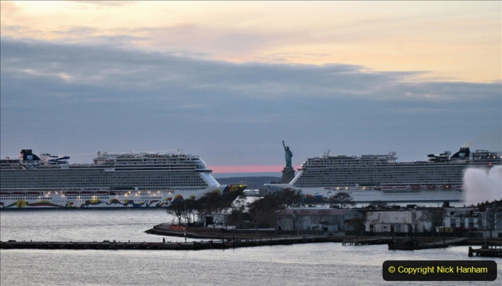 2019-11-10 New York. (389) Norwegin Encore & Norwegin Escape pass in NY Harbour with a tug boat water display escort. 389