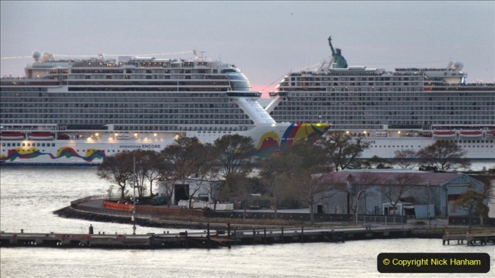 2019-11-10 New York. (393) Norwegin Encore & Norwegin Escape pass in NY Harbour with a tug boat water display escort. 393