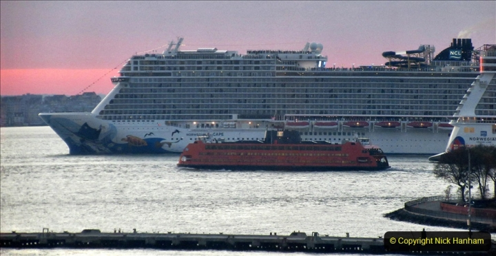 2019-11-10 New York. (398) Norwegin Encore & Norwegin Escape pass in NY Harbour with a tug boat water display escort. 398