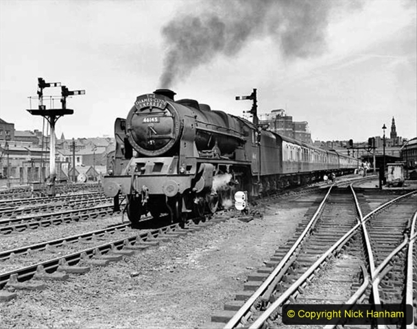 UNITED KINGDOM - MAY 16:  British Railways Royal Scot class 4-6-0 steam locomotive No 46145 'Duke of Wellington's Regiment' leaving Leeds with the Thames-Clyde passenger express from London to Glasgow. Photographer Eric Treacy.  (Photo by SSPL/Getty Images)