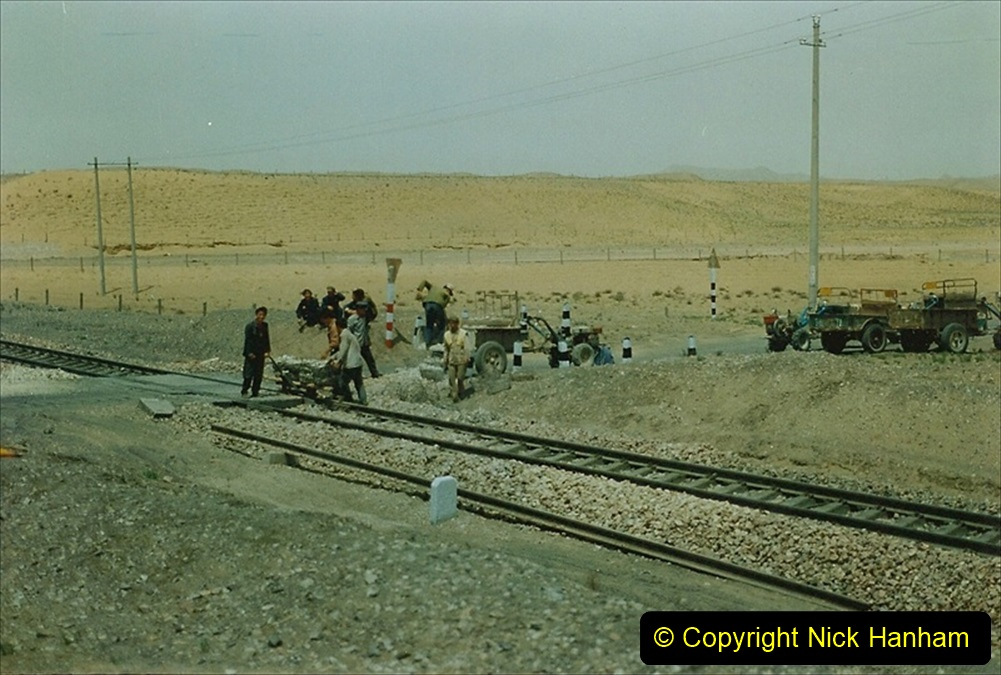 Pakistan and China 1996 June. (158) Linesiding on the way to Baotou and local village. 158