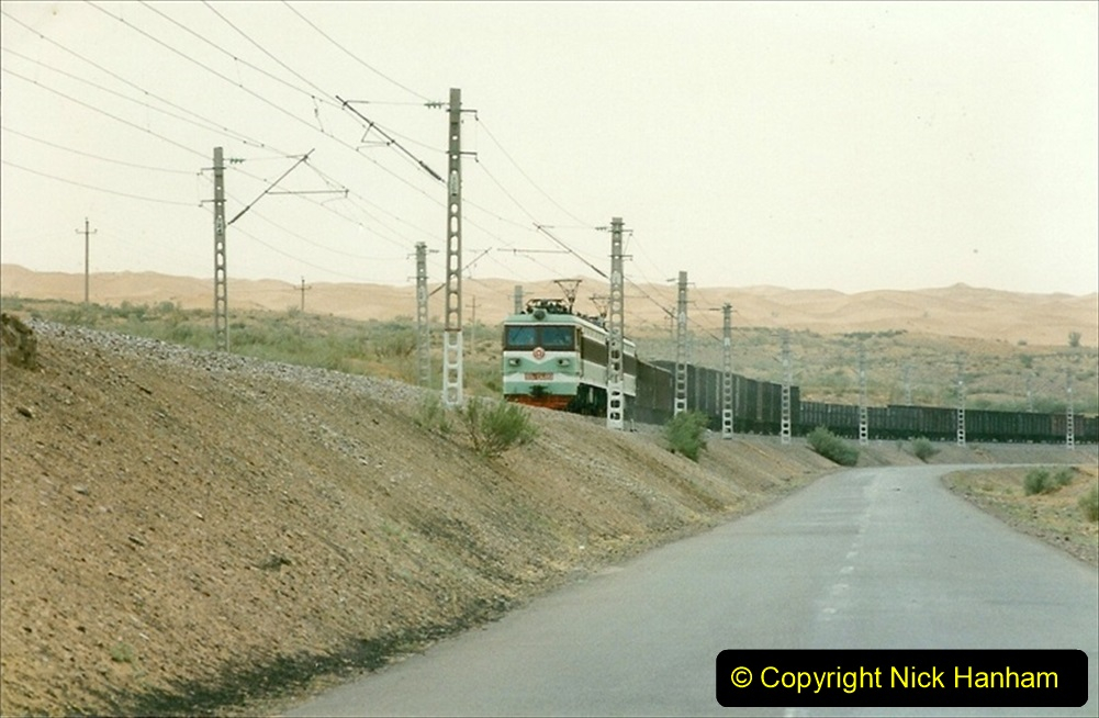 Pakistan and China 1996 June. (81) On the BIG Hill outside Zhongwei now electric.  081