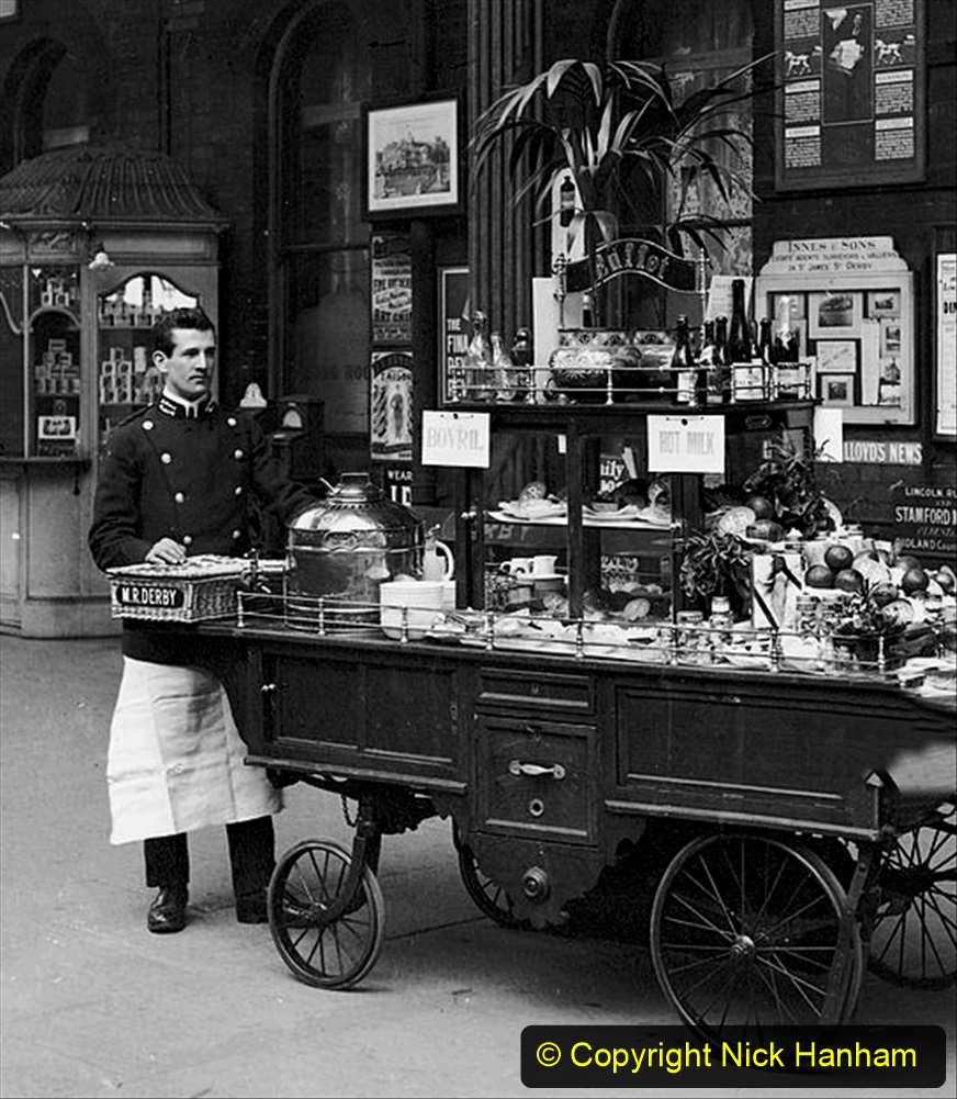 UNITED KINGDOM - NOVEMBER 15:  Buffet refreshment trolley with attendant, Derby station, Derbyshire, 23 February 1908. Buffet refreshment trolley with attendant, Derby station, Derbyshire, 23 February 1908. Refreshments on offer include fruit, Bovril, hot milk and Bolinger champagne. Midland Railway official photograph.  (Photo by Science & Society Picture Library/SSPL/Getty Images)