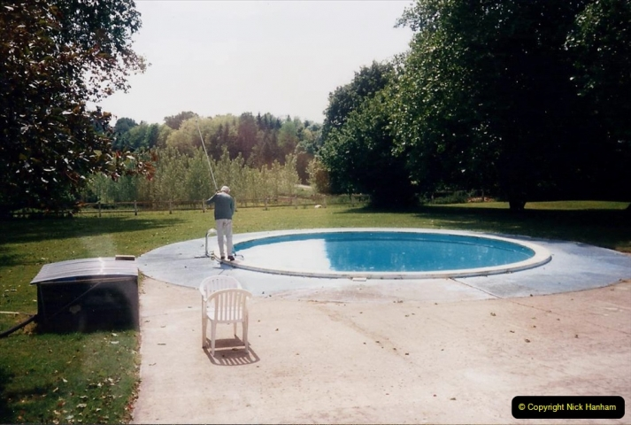 1995 France May - June. (14) At Villechaise for our stay in france. Our Host cleans the pool.14