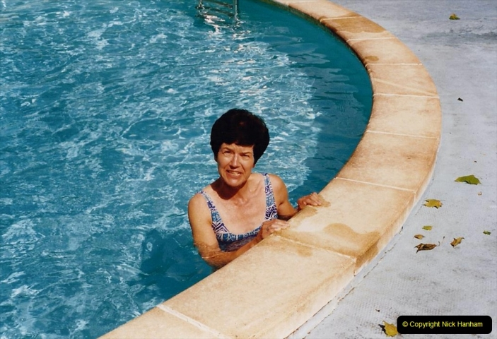 1995 France May - June. (15) At Villechaise for our stay in france. Your Host's Wife enjoys the pool.15