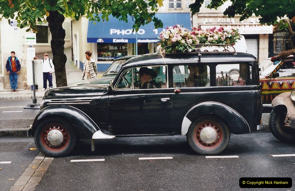 2000 France in September. (39) Morlaix with a selection of vintage vehicles. 39