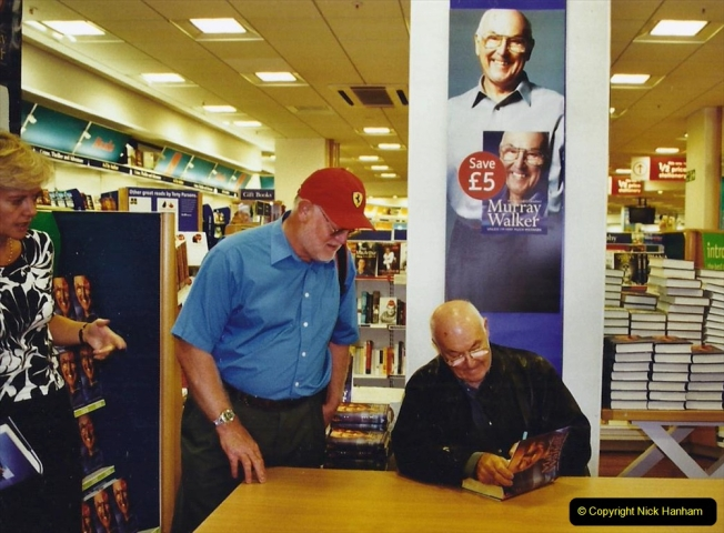 2002 Miscellaneous. (212) Murray Walker signing his book for your Host. 212