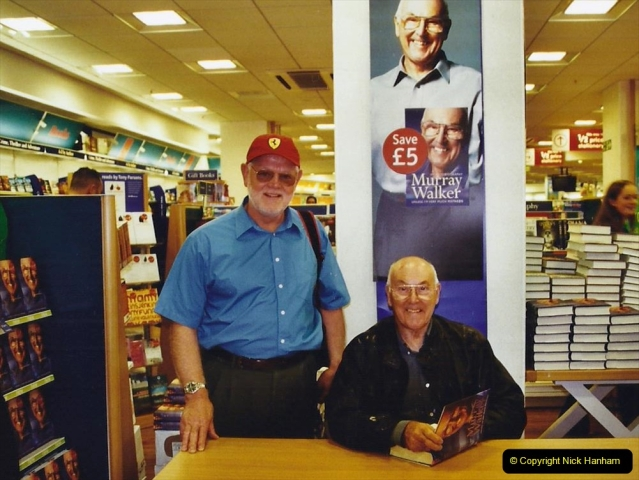 2002 Miscellaneous. (213) Murray Walker signing his book for your Host. 213