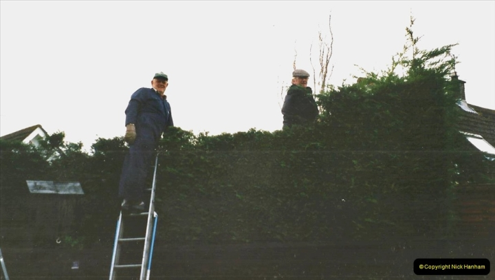 2002 Miscellaneous. (291) Your Host and friend Tony lowering my house hedge height. 291
