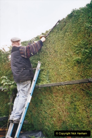 2002 Miscellaneous. (293) Your Host and friend Tony lowering my house hedge height. 293