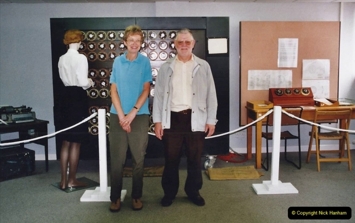 2002 Miscellaneous. (80) Bletchley Park Near Milton Keynes, Bedfordshire. Your Host with friend stand in front of Alan Turing's Bomb.080