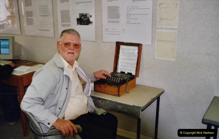 2002 Miscellaneous. (82) Bletchley Park Near Milton Keynes, Bedfordshire. A German ENIGMA code machine. Your Host having a go on the coade machine.082